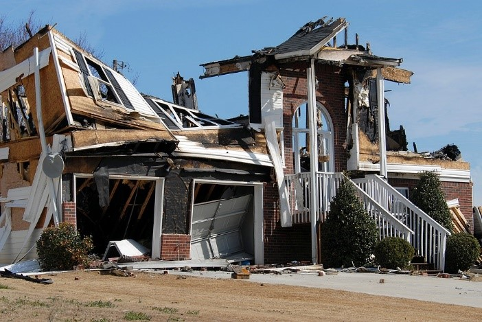a house damaged from a natural disaster