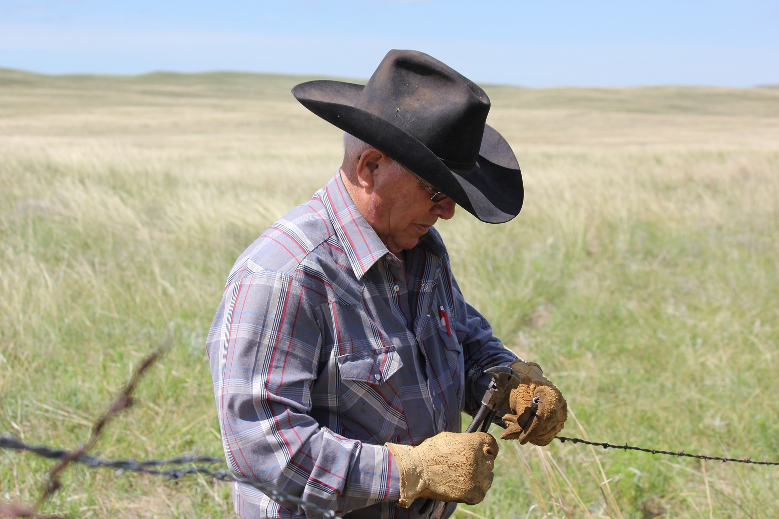farmer repairing fence