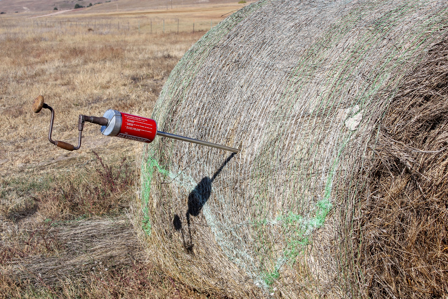 Hay probe in a round bale.