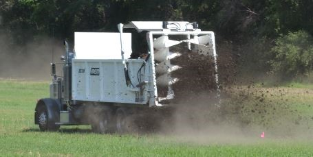 Truck applying manure to a field