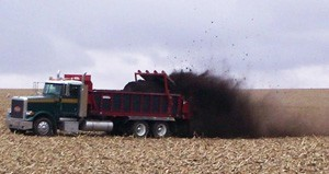 photo - spreading manure on field