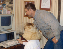 photo of couple at computer